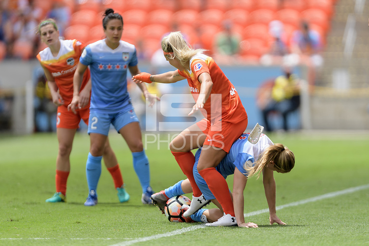 Houston, TX - Saturday April 15, 2017: Rachel Daly and Alyssa Mautz battle for control of the ball during a regular season National Women's Soccer League (NWSL) match won by the Houston Dash 2-0 over the Chicago Red Stars at BBVA Compass Stadium.