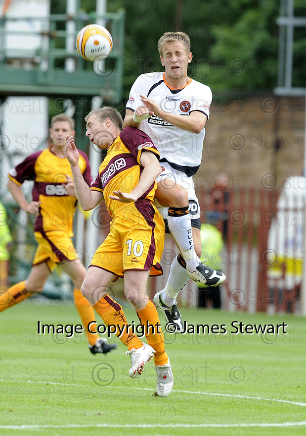 23/08/2008  Copyright Pic: James Stewart.File Name : sct_jspa11_motherwell_v_dundee_utd.DANNY GRAINGER GETS ABAOVE KEITH LASLEY.James Stewart Photo Agency 19 Carronlea Drive, Falkirk. FK2 8DN      Vat Reg No. 607 6932 25.James Stewart Photo Agency 19 Carronlea Drive, Falkirk. FK2 8DN      Vat Reg No. 607 6932 25.Studio      : +44 (0)1324 611191 .Mobile      : +44 (0)7721 416997.E-mail  :  jim@jspa.co.uk.If you require further information then contact Jim Stewart on any of the numbers above........
