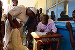 TANZANIA Mara, Tarime, village Masanga, region of the Kuria tribe who practise FGM Female Genital Mutilation, temporary rescue camp of the Diocese Musoma for girls which escaped from their villages to prevent FGM / TANSANIA Mara, Tarime, Dorf Masanga, in der Region lebt der Kuria Tribe, der FGM weibliche Genitalbeschneidung praktiziert, temporaerer Zufluchtsort fuer Maedchen, denen in ihrem Dorf Genitalverstuemmelung droht, in einer Schule der Dioezese Musoma, Schwestern DAUGHTERS OF CHARITY (ST. VINCENT DE PAUL), Schwester SR. CLEMENTINE NDOOLE empfaengt neue Maedchen aus den Doerfern, Aufnahme der Neuankoemmlinge