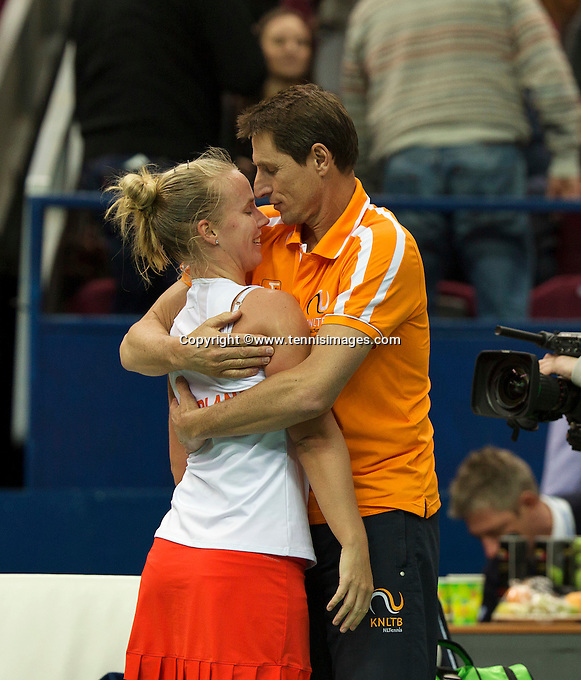 Moskou, Russia, Februari 4, 2016,  Fed Cup Russia-Netherlands, Richel Hogenkamp (NED) jis congratulated by captain Paul Haarhuis after defeating Kuznetsova, Netherlands lead 2-0<br /> Photo: Tennisimages/Henk Koster
