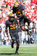 College Park, MD - SEPT 23, 2017: Maryland Terrapins defensive back Antwaine Richardson (20) and Maryland Terrapins defensive end Melvin Keihn (15) celebrate a big defensive stop during game between Maryland and UCF at Capital One Field at Maryland Stadium in College Park, MD. (Photo by Phil Peters/Media Images International)