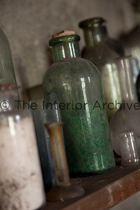 Bottles, corked and broken, still line the shelves as they did 150 years ago