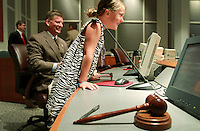 Kelly.Jordan@jacksonville.com--053111--Emma Joost, 6, leans over the desk and checks out the view from where her father Stephen C. Joost, left, the newly elected City Council president sits as the City Council 2011-15 members meet for the first time and elect their new Council president and vice president, Tuesday morning May 31, 2011. Joost's family was on hand as he was elected to be the new City Council president.(The Florida Times-Union, Kelly Jordan)
