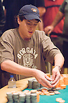 Mark Newhouse stacks the chips he won when he knocked out Jennifer Tilly.