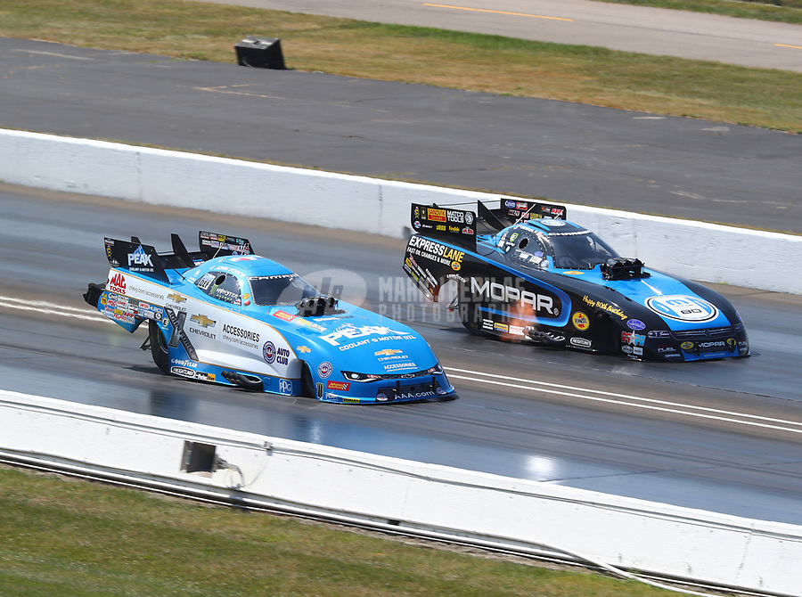 Sep 3, 2017; Clermont, IN, USA; NHRA funny car driver John Force (near) races alongside Matt Hagan during qualifying for the US Nationals at Lucas Oil Raceway. Mandatory Credit: Mark J. Rebilas-USA TODAY Sports