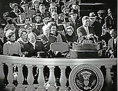 United States President John F. Kennedy delivers his Inaugural Address after being sworn-in as the 35th President of the United States on the East Front of the U.S. Capitol in Washington, D.C. on Friday, January 20, 1961.  First Lady Jacqueline Kennedy, former U.S. President Dwight D. Eisenhower, and U.S. Chief Justice Earl Warren look on from the left and U.S. Vice President Lyndon B. Johnson looks on from the right..Credit: Arnie Sachs / CNP