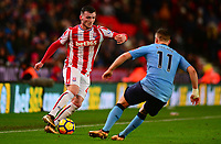 Tom Edwards of Stoke battles with Newcastle of Stoke during the EPL - Premier League match between Stoke City and Newcastle United at the Britannia Stadium, Stoke-on-Trent, England on 1 January 2018. Photo by Bradley Collyer / PRiME Media Images.