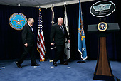 Arlington, VA - January 4, 2006 -- United States Vice President Dick Cheney (R) and Secretary of Defense Donald Rumsfeld (left) looks for their spots prior to remarks by President George W. Bush January 4, 2006 at the Pentagon in Arlington, Virginia. Bush was at the Pentagon for a briefing on the war by top commanders. He also offered condolences to the families of the 12 West Virginia miners who were found dead after a frantic rescue effort following an explosion at the Sago mine January 2, 2006.<br /> Credit: Alex Wong - Pool via CNP