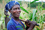 """A woman returns from working in her farm field in Chisatha, a village in southern Malawi. Her community has been hard hit by drought in recent years, leading to chronic food insecurity, especially during the """"hunger season,"""" when farmers are waiting for the harvest."""