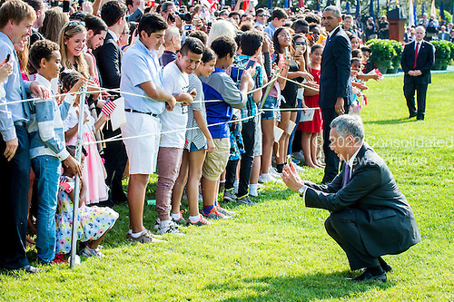Prime Minister Lee Hsien Loong of Singapore takes a photo of a little girl while greeting guests during official welcoming ceremonies on the South Lawn of the White House in Washington, DC on August 2, 2016. Lee is on a State Visit to the United States.  <br /> Credit: Pete Marovich / Pool via CNP