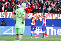 Atletico de Madrid´s Diego Costa celebrates a goal with Filipe Luis in front of Milan´s goalkeeper Christian Abbiati during 16th Champions League soccer match at Vicente Calderon stadium in Madrid, Spain. March 11, 2014. (ALTERPHOTOS/Victor Blanco)