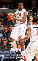 Dec. 22, 2010; Charlottesville, VA, USA; Virginia Cavaliers forward Akil Mitchell (25) grabs a rebound during the game against the Seattle Redhawks at the John Paul Jones Arena. Mandatory Credit: Andrew Shurtleff