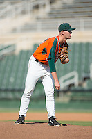 Greensboro Grasshoppers relief pitcher Kyle Keller (22) looks to his catcher for the sign against the Kannapolis Intimidators at Intimidators Stadium on July 17, 2016 in Greensboro, North Carolina.  The Intimidators defeated the Grasshoppers 3-2 in game one of a double-header.  (Brian Westerholt/Four Seam Images)