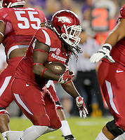 11/14/15<br /> Arkansas Democrat-Gazette/STEPHEN B. THORNTON<br /> Arkansas' Alex Collins breaks through the line for a long run for the hogs second TD  during the second quarter of their game Saturday in Baton Rouge, La.