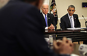 United States President Barack Obama (R) speaks as Vice President Joseph Biden (2nd R) listens during a Democratic Governors Association Meeting in the Eisenhower Executive Office Building February 20, 2015 in Washington, DC. The nation's governors are in Washington, DC, to attend the National Governors Association's Winter Meeting. <br /> Credit: Alex Wong / Pool via CNP