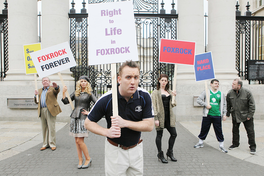 """NO FEE. 14/10/2010. SAVE OUR FOXROCK. The cast of Ross O'Carroll-Kelly play gather to protest outside Government Buildings to protest the recent decision to rezone Foxrock to Sandyford East as their play """"Between Foxrock and a hard place"""" gets ready to open. L- R are Lisa Lambe, Rory Nolan {Ross O'Carroll-Kelly, Lawrence Kinlan, Aoibhinn McGinnity, Philip O Sullivan and Gary Cooke. Picture James Horan/Collins Photos"""