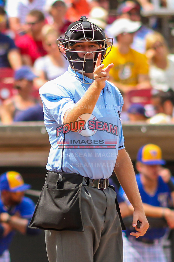 Home plate umpire Robert Nunez makes a strike call during a Midwest League game between the Cedar Rapids Kernels and the Wisconsin Timber Rattlers on August 6, 2017 at Fox Cities Stadium in Appleton, Wisconsin.  Cedar Rapids defeated Wisconsin 4-0. (Brad Krause/Four Seam Images)