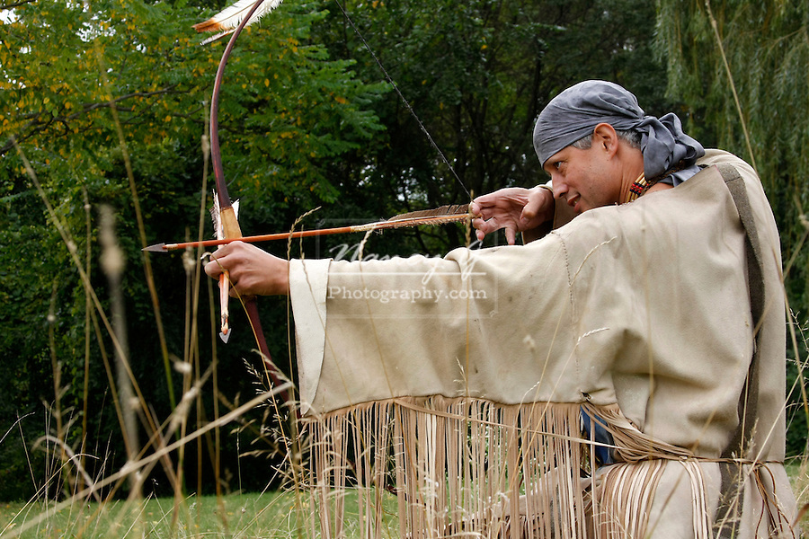 Native American Indian man with a bow and arrow hunting