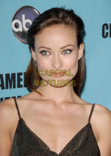 OLIVIA WILDE  .at the 24th annual American Cinematheque Award presentation to Matt Damon held at The Beverly Hilton Hotel in Beverly Hills, California, USA, March 27th 2010                                                                    .portrait headshot  make-up straps  gold bronze sequined sequin .CAP/RKE/DVS.©DVS/RockinExposures/Capital Pictures