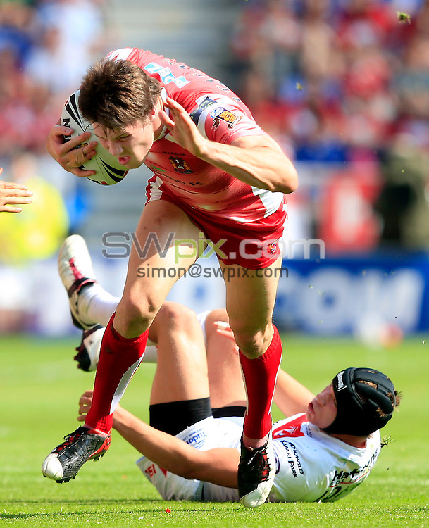 PICTURE BY CHRIS MANGNALL /SWPIX.COM...Rugby League - Super League  -  Wigan Warriors v St Helens Saints  - DW  Stadium, Wigan, England  - 22/04/11... Wigan's  Joel Tomkins  tackled by St Helens Jonny Lomax.