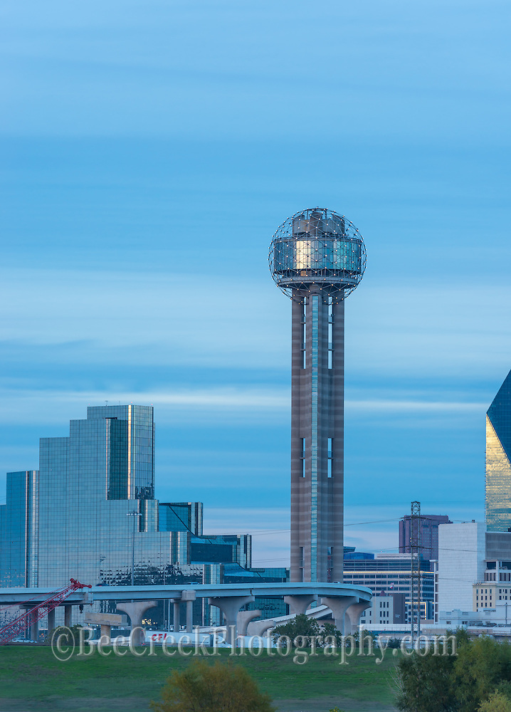 This is another image of the Reunion Tower as twilight set in the city.