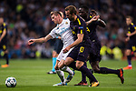 Toni Kroos of Real Madrid (L) fights for the ball with Harry Kane of Tottenham Hotspur FC (C) and Moussa Sissoko of Tottenham Hotspur FC (R) during the UEFA Champions League 2017-18 match between Real Madrid and Tottenham Hotspur FC at Estadio Santiago Bernabeu on 17 October 2017 in Madrid, Spain. Photo by Diego Gonzalez / Power Sport Images
