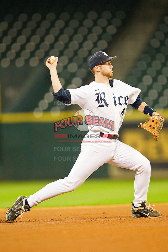 Rice Owls shortstop Derek Hamilton #4 makes a throw to first base against the Texas Longhorns at Minute Maid Park on March 2, 2012 in Houston, Texas.  The Longhorns defeated the Owls 11-8.  (Brian Westerholt/Four Seam Images)