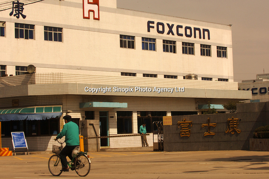 Taiwanese owned Foxconn plant in Kunshan, (near Shanghai), China. The sprawling plant here employs tens of thousands of workers mostly involved in producing cabling, much of it for Apple Computers and accessories. Payment for labour (before overtime) is as low as 300 RMB for starting employees (20 pounds sterling). Foxconn employ almost a million workers in China..23 Feb 2006