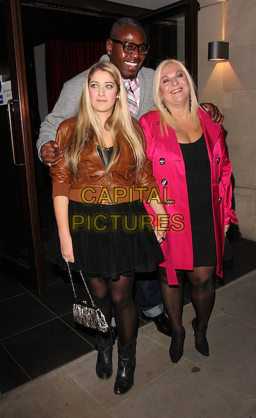 SASKIA, BEN OFOEDU & VANESSA FELTZ.Nicky Haslam Book Launch party for his autobiography 'Redeeming Features' at Aqua, London, USA..November 5th 2009.full length black skirt pink coat jacket  mother mom mum daughter family brown leather .CAP/ROS.©Steve Ross/Capital Pictures.