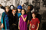 5th Grade children dressed up in costume for halloween dance differing heights and rates of development horizontal