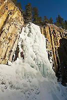 Pallisade Falls in Hyalite Canyon glistens under a winter sun south of Bozeman, Montana.