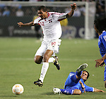 7 June 2007: Trinidad's Darryl Roberts (14) leaps over the tackle attempt from an El Salvador defender. The National Team of El Salvador defeated the National Team of Trinidad & Tobago 2-1 at the Home Depot Center in Carson, California in a first round game in the CONCACAF Gold Cup.