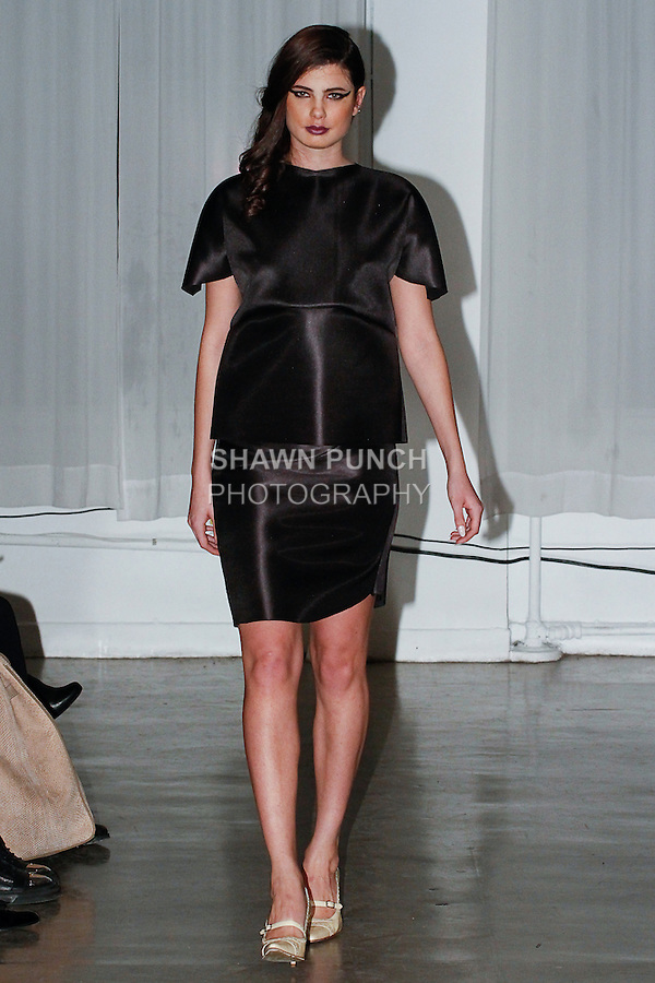 Model walks runway in an outfit from the Chantell Walters Fall Winter 2014 collection fashion show, at 320 West 37th Street, in New York City, during New York Fashion Week Fall 2014, February 7, 2014.