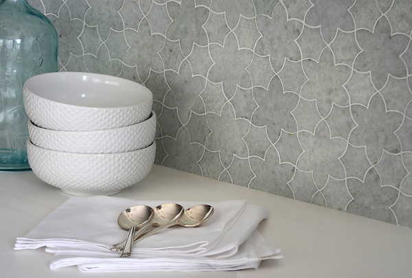 Cadiz, a waterjet mosaic shown in  polished Ming Green, is part of the Miraflores collection by Paul Schatz for New Ravenna.