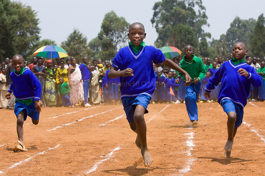 May0016089 . Daily Telegraph..Features.. Children taking part in a race during the opening ceremony for the Ngwino Nawe (Come To Us) Children's Village built by Rwanda Aid a British charity and recipient of funds from the Daily Telegraph's 2005 Christmas appeal..Built in Ntendezi in south west Rwanda, the village acts as both home and school for orphans, some victims of the 1994 genocide, and the mentally and physically handicapped...Rwanda 28 August 2009