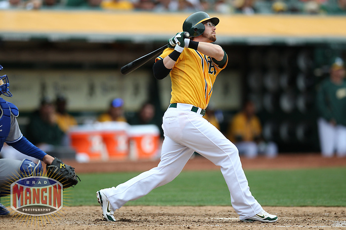 OAKLAND, CA - AUGUST 4:  Eric Sogard #28 of the Oakland Athletics bats against the Toronto Blue Jays during the game at O.co Coliseum on Saturday, August 4, 2012 in Oakland, California. Photo by Brad Mangin
