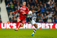 29th December 2019; The Hawthorns, West Bromwich, West Midlands, England; English Championship Football, West Bromwich Albion versus Middlesbrough; Kyle Edwards of West Bromwich Albion wins the ball from Jonny Howson of Middlesbrough - Strictly Editorial Use Only. No use with unauthorized audio, video, data, fixture lists, club/league logos or 'live' services. Online in-match use limited to 120 images, no video emulation. No use in betting, games or single club/league/player publications