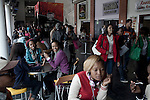 BLOEMFONTEIN, SOUTH AFRICA APRIL 17, 2013: Students in the lunch areas at the University of the Free State in Bloemfontein, South Africa. Races are mixing more but often they socialize with their own kind. Photo by: Per-Anders Pettersson