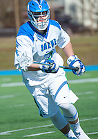 Frank Russo,'16, charges the field as the Seahawks battle Endicott in Men's Lacrosse game action at Gaudet Field in Middletown.