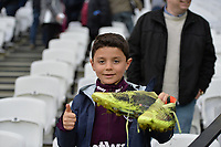 Marko Arnautovic of West Ham gives away his boots to a west ham fan during West Ham United vs Burnley, Premier League Football at The London Stadium on 10th March 2018