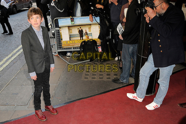 "BILL MILNER.The ""Is Anybody There?"" UK premiere, Curzon Mayfair, London, England. .April 29th, 2009 .full length grey gray suit jacket check shirt black jeans denim red doc dr. martens boots shoes .CAP/CAS.©Bob Cass/Capital Pictures."