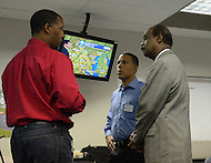 August 30, 2011 (Bethesda, MD)  Maryland Lt. Governor Anthony G. Brown (c) and Montgomery County Executive Ike Leggett (r) toured a Pepco Control Center with Pepco's President Thomas H. Graham.  The Center is a hub where Pepco's master computers are located, and where power to and from various points within the region can be controlled during an emergency.    (Photo by Don Baxter/Media Images International)