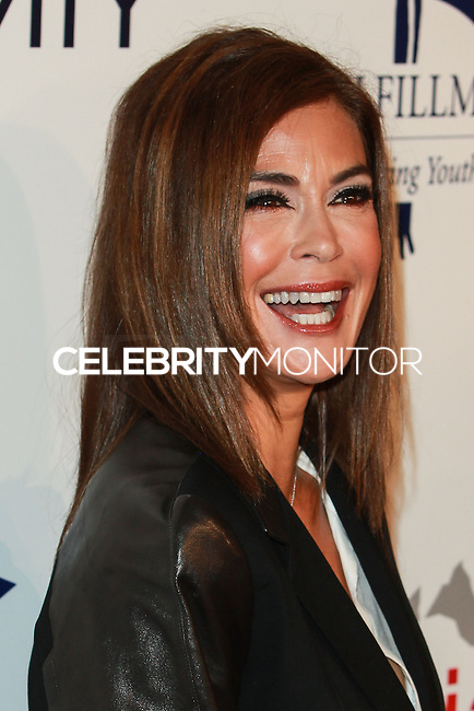 BEVERLY HILLS, CA, USA - OCTOBER 14: Teri Hatcher arrives at the 20th Annual Fulfillment Fund Stars Benefit Gala held at The Beverly Hilton Hotel on October 14, 2014 in Beverly Hills, California, United States. (Photo by David Acosta/Celebrity Monitor)