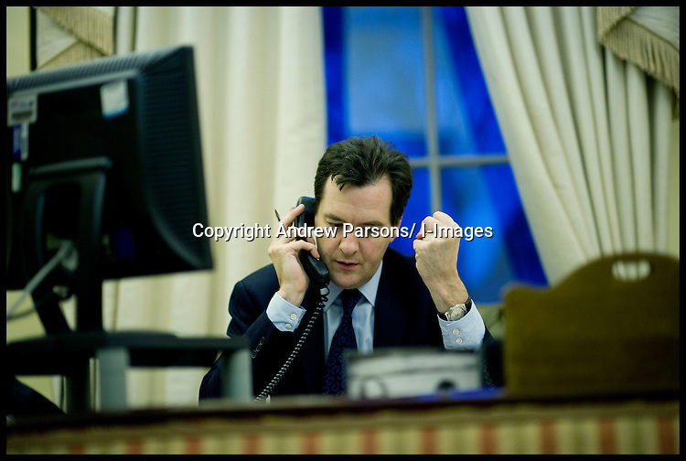 Chancellor of the Exchequer George Osborne on the phone in his office in No11 Downing Street to the Danish Finance Minister, Wednesday February 8th, 2012. Photo By Andrew Parsons/ i-Images