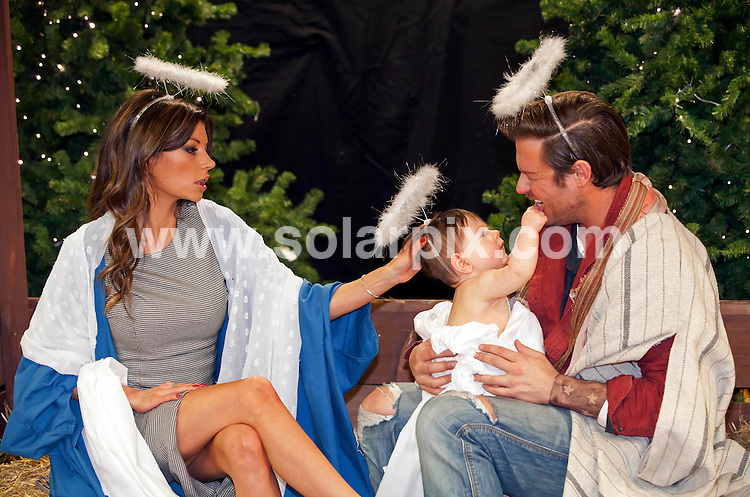 **ALL ROUND PICTURES FROM SOLARPIX.COM**                                             **NO UK NEWSPAPER PUBLICATION**.**UK MAGAZINE & SUPPLEMENT PUBLICATION ONLY** AND NO PUBLICATION IN AUSTRALIA, BELGIUM, FRANCE, GERMANY, ITALY, SCANDINAVIA AND USA**                                                                                  Caption: Victoria and David Beckham lookalikes pose in a nativity scene at Harrods in London  to launch Photographer Alison Jackson's new book Exposed                                                                              This pic: Victoria and David Beckham lookalikes                                                                                             JOB REF:14308        SFE       DATE:20.12.11                                                            **MUST CREDIT SOLARPIX.COM OR DOUBLE FEE WILL BE CHARGED**                                                                      **MUST AGREE FEE BEFORE ONLINE USAGE**                               **CALL US ON: +34 952 811 768 or LOW RATE FROM UK 0844 617 7637**