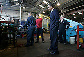 Bedford Heights, OH - January 16, 2009 -- United States President Elect Barack Obama (C) looks on as workers manufacture a bolt at Cardinal Fastener & Specialty Company, Inc., in Bedford Heights, Ohio, USA, 16 January 2009.  Obama met with workers at the plant, which manufactures parts used to construct wind turbines, to discuss an American Recovery and Reinvestment Plan, which would aim to create nearly half a million American jobs by investing in clean energy.  .Credit: David Maxwell - Pool via CNP
