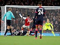 Alexis Sanchez of Arsenal is foiled by Christopher Schindler of Huddersfield Town during the Premier League match between Arsenal and Huddersfield Town at the Emirates Stadium, London, England on 29 November 2017. Photo by Carlton Myrie / PRiME Media Images.