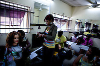 """Hair dressing students practice at the """"Downtown beauty salon"""" where several Nollywood stars frequently have their hair styled by head hair dresser Agnes Adamson and her staff in Lagos, Nigeria on Friday March 27 2009..Currently the most requested hair styles at the salon are """"Take a bow"""" and Crazy Alia""""...Currently, Nigerian films outsell Hollywood films in Nigeria and many other African countries..Nollywood is a nascent film industry in Nigeria, growing up within the last two decades to become the third largest film industry on the planet, behind the United States and Indian film industries. Nigeria has a US$250 million movie industry, churning out some 200 videos for the home video market every month."""