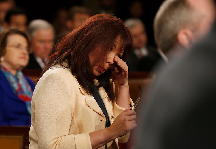 U.S. Rep. Tammy Duckworth wipes tears from her eyes during a standing ovation for U.S. Army Ranger Sgt. First Class Cory Remsburg, injured while serving in Afghanistan, who was a guest in first lady Michelle Obama's box during President Barack Obama's State of the Union speech on Capitol Hill in Washington, January 28, 2014. REUTERS/Larry Downing (UNITED STATES  - Tags: POLITICS)