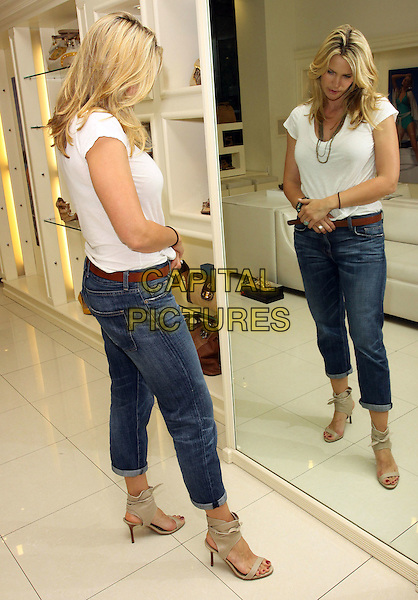 NATASHA HENSTRIDGE.Natasha Henstridge Visits Gifting Services held at Gifting Services Showroom, Los Angeles, CA, USA..June 3rd, 2010.full length white top jeans denim rolled turned up mirror reflection sandals .CAP/ADM/KB.©Kevan Brooks/AdMedia/Capital Pictures.